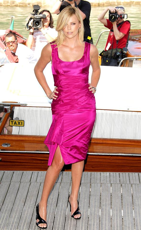 """Charlize Theron's curve-hugging fuchsia frock is beyond fabulous. Daniele Venturelli/<a href=""""http://www.wireimage.com"""" target=""""new"""">WireImage.com</a> - August 29, 2008"""