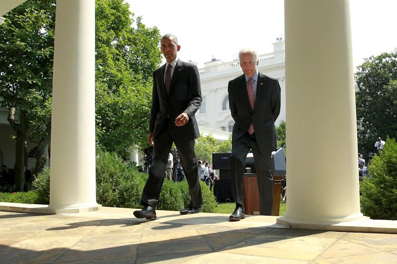 U.S. President Barack Obama (L) and Vice President Joe Biden depart after announcing the restoration of diplomatic ties with Cuba in the Rose Garden at the White House in Washington July 1, 2015. Obama said on Wednesday the United States had agreed to the historic step of re-establishing diplomatic relations with Cuba and will raise its flag over a U.S. Embassy in Havana later this summer. REUTERS/Jonathan Ernst