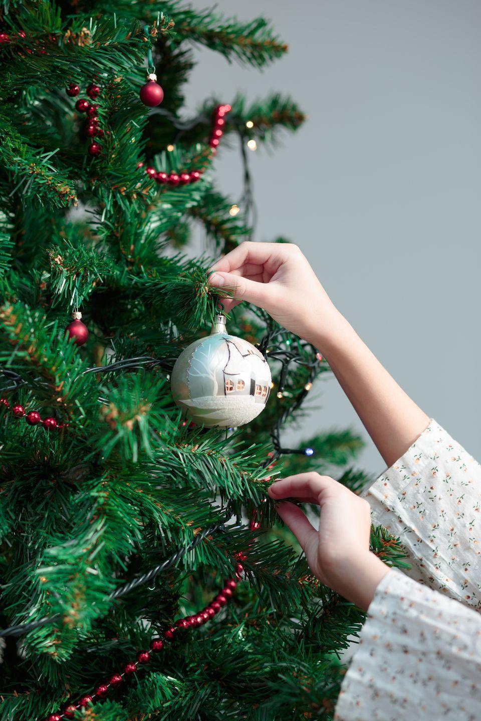 """<p>You likely already have """"decorate the tree"""" on your family's Christmas bucket list, but you can add another layer of excitement to this activity: Give each kid a mini spruce for their room and encourage them to come up with a <a href=""""https://www.oprahmag.com/life/g29114554/christmas-tree-decorating-ideas/"""" rel=""""nofollow noopener"""" target=""""_blank"""" data-ylk=""""slk:creative theme for trimming it"""" class=""""link rapid-noclick-resp"""">creative theme for trimming it</a>. </p><p><a class=""""link rapid-noclick-resp"""" href=""""https://www.oprahmag.com/entertainment/g28772609/harry-potter-ornaments/"""" rel=""""nofollow noopener"""" target=""""_blank"""" data-ylk=""""slk:SHOP THEMED ORNAMENTS"""">SHOP THEMED ORNAMENTS</a></p>"""