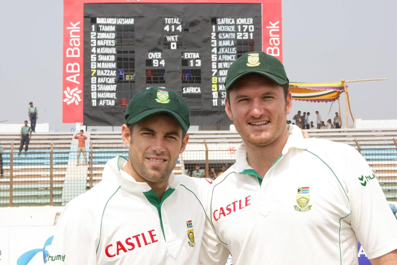 CHITTAGONG, BANGLADESH - MARCH 3:   Neil McKenzie and Graeme Smith of South Africa poses with the scoreboard for their World Record opening stand during day four of the second test match between Bangladesh and South Africa held at the Shrestha Shahid Ruhul Amin Stadium on March 3, 2008 in Chittagong, Bangladesh. (Photo by Duif du Toit/Gallo Images/Getty Images)