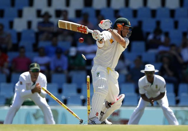 Australia's David Warner is bowled out by South Africa's Dale Steyn delivery during the first day of their cricket test match in Centurion February 12, 2014. REUTERS/Siphiwe Sibeko (SOUTH AFRICA - Tags: SPORT CRICKET TPX IMAGES OF THE DAY)