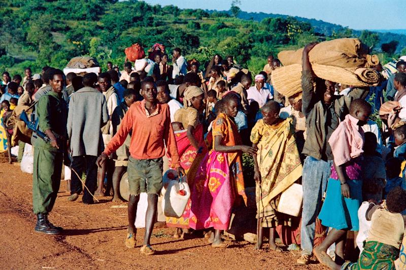 Refugees from Rwanda who were forced to flee their homes due to ethnic carbage are checked on April 19, 1994 at the border in Gasenyi, Burundi, before being sent to a refugee camp (AFP Photo/Pascal Guyot)