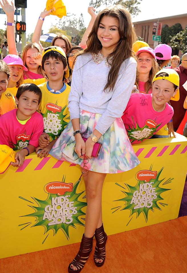 "<p class=""MsoNormal""><span style=""font-family:Calibri;"">Zendaya has been doing the foxtrot in sparkly frocks on ""Dancing With the Stars,"" but the cute starlet opted for a less bedazzled look at the Nickelodeon Teen Choice Awards. She hit the orange carpet in a watercolor skirt and lavender sweater with a beaded collar. Hey – if you're on ""DWTS"" you gotta have a little bling! (3/23/2013)<br><br><br></span></p>"