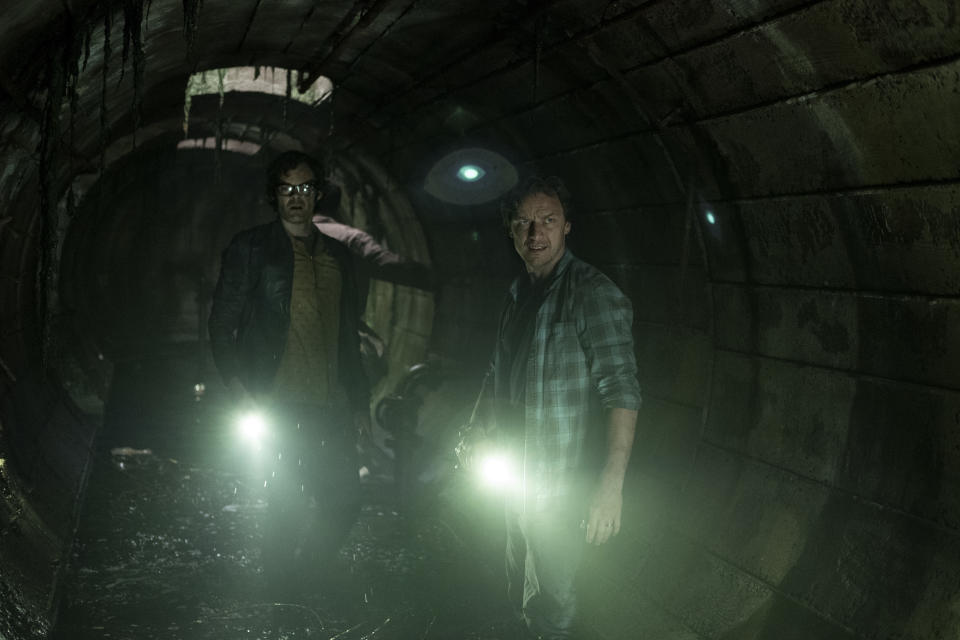 Bill Hader and James McAvoy exploring the sewers of Derry in <i>It: Chapter Two</i>. (Warner Bros.)