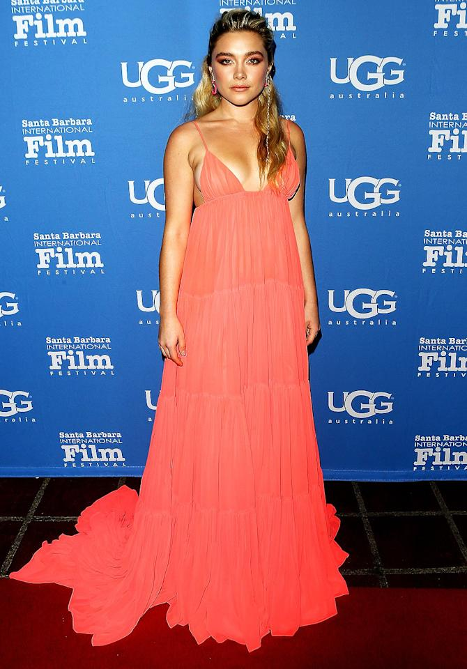 has a maxi moment in a coral pleated gown at the Santa Barbara Film Festival in Santa Barbara, Calif.