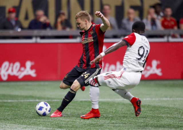 Atlanta United defender Julian Gressel (24) shoots in the first half of an MLS soccer game against the D.C. United on Sunday, March 12, 2018, in Atlanta. (AP Photo/Todd Kirkland)