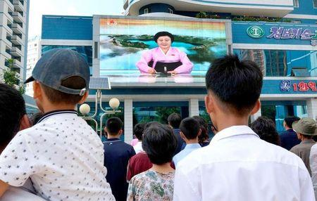 North Koreans watch a news report showing North Korea's nuclear test on electronic screen in Pyongyang, North Korea,  in this photo taken by Kyodo September 3, 2017. Mandatory credit Kyodo/via REUTERS