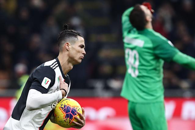 Cristiano Ronaldo celebrates after scoring the stoppage-time penalty that gave Juventus a 1-1 draw at AC Milan in Thursday's Italian Cup semifinal first leg. (Isabella Bonotto/Getty)