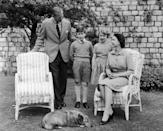 <p>Queen Elizabeth II, Prince Philip, Prince Charles, and Princess Anne relax with Sugar, the Queen's corgi. </p>
