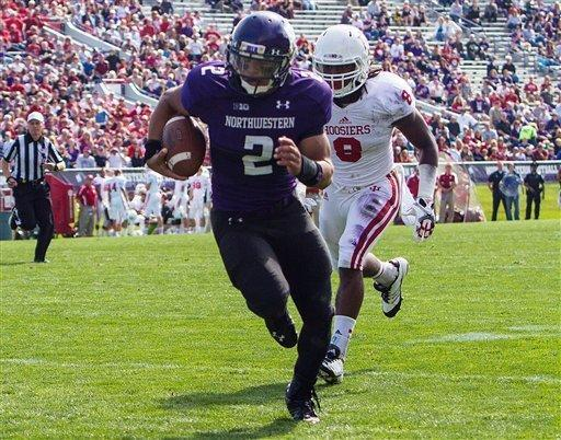 Northwestern's Kain Kolter (2) runs for a touchdown against Indiana during the second quarter of an NCAA college football game in Evanston, Ill. on Saturday, Sept. 29, 2012. (AP Photo/Charles Cherney)