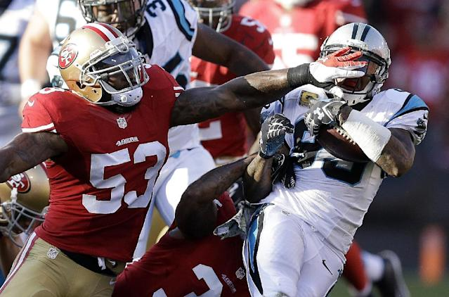 Carolina Panthers' Steve Smith, right, is tackled by San Francisco 49ers' NaVorro Bowman (53) during the third quarter of an NFL football game in San Francisco, Sunday, Nov. 10, 2013. (AP Photo/Ben Margot)