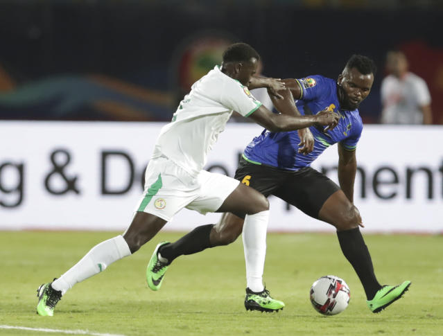 Senegal's Mbaye Hamady Niang, left, and Tanzania's Agrey Moris Ambros fight for the ball during the African Cup of Nations group C soccer match between Senegal and Tanzania at 30 June Stadium in Cairo, Egypt, Sunday, June 23, 2019. (AP Photo/Hassan Ammar)