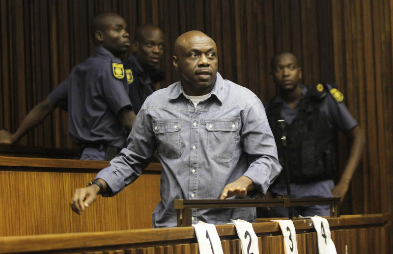 FILE - In this Monday Jan. 21 2013 file photo, Nigerian terror suspect Henry Okah is seen  in court in Johannesburg  Okah, who  was found guilty of masterminding twin car bombings during independence celebrations in October 2010 in Nigeria killing at least 12 people and wounding three dozen, was sentenced to 24 years in jail Tuesday March 26 2013.(AP Photo/File)