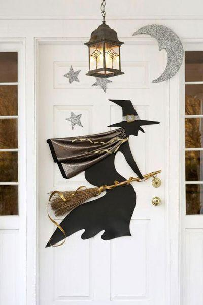 """<p>Use our free template to cut out a simple silhouette (and some twinkling Styrofoam stars) that will bewitch everyone who comes to your door.</p><p><em><a href=""""https://www.goodhousekeeping.com/holidays/halloween-ideas/a19159/printable-halloween-witch-template/"""" rel=""""nofollow noopener"""" target=""""_blank"""" data-ylk=""""slk:Get the tutorial »"""" class=""""link rapid-noclick-resp"""">Get the tutorial »</a></em></p><p><a class=""""link rapid-noclick-resp"""" href=""""https://www.amazon.com/Sulyn-SUL51121-oz-Glitter-Jar/dp/B0090B8K8O/ref=sr_1_2?tag=syn-yahoo-20&ascsubtag=%5Bartid%7C10055.g.4602%5Bsrc%7Cyahoo-us"""" rel=""""nofollow noopener"""" target=""""_blank"""" data-ylk=""""slk:SHOP GLITTER"""">SHOP GLITTER</a></p>"""