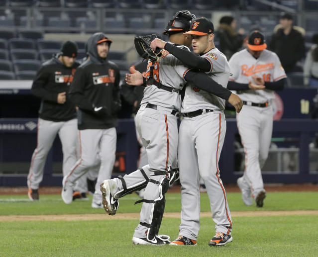 Baltimore Orioles relief pitcher Paul Fry, right, and catcher Pedro Severino celebrate after a baseball game against the New York Yankees at Yankee Stadium, Sunday, March 31, 2019, in New York. (AP Photo/Seth Wenig)