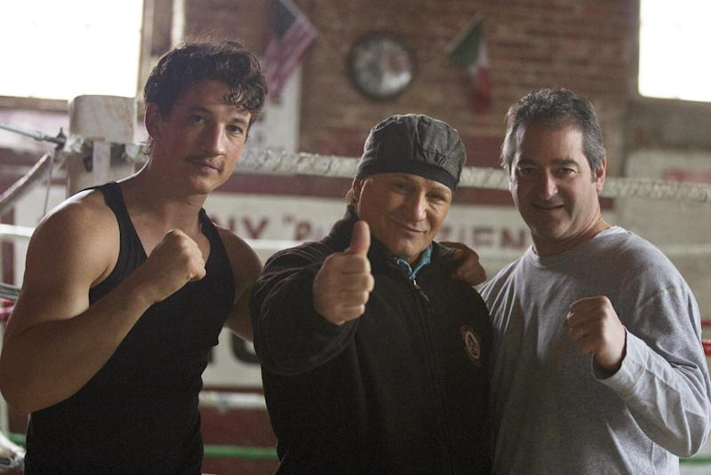 """In this image released by Open Road Films, actor Miles Teller, left, former boxer Vinny """"Paz"""" Pazienza, center, and film producer Chad Verdi pose on the set of """"Bleed For This."""" The film, based on Pazienza's life, opens November 18. (Seacia Pavao/Open Road Films via AP)"""