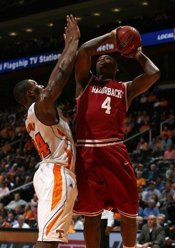 Arkansas forward Devonta Abron (4) shoots over Tennessee forward Jeronne Maymon (34) during the second half of an NCAA college basketball game at Thompson-Boling Arena in Knoxville, Tenn., Wednesday, Feb. 15, 2012. Tennessee won 77-58 over Arkansas. (AP Photo/Knoxville News Sentinel, Adam Brimer)