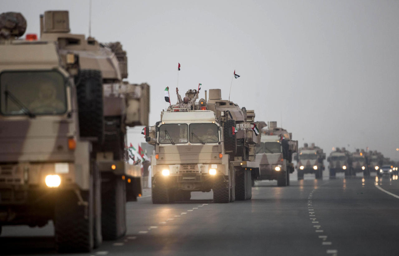 <p> FILE- In this Nov. 7, 2015 file photo, made available by the Emirates News Agency, WAM, a convoy of UAE military vehicles and personnel travels from Al Hamra Military Base to Zayed Military City, marking the return of the first batch of UAE Armed Forces military personnel from Yemen, in Abu Dhabi, United Arab Emirates. The UAE is better known for its skyscrapers and pampered luxuries, but its battle-hardened military that's gained on-the-ground experience in the last decades is expanding into new bases in Africa. (Ryan Carter-Crown Prince Court - Abu Dhabi/WAM via AP) </p>