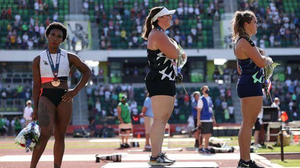 PHOTO: Gwendolyn Berry turns away from U.S. flag as DeAnna Price and Brooke Andersen stand on the podium after the Women's Hammer Throw final on day nine of the 2020 U.S. Olympic Track & Field Team Trials at Hayward Field on June 26, 2021, in Eugene, Ore. (Patrick Smith/Getty Images)