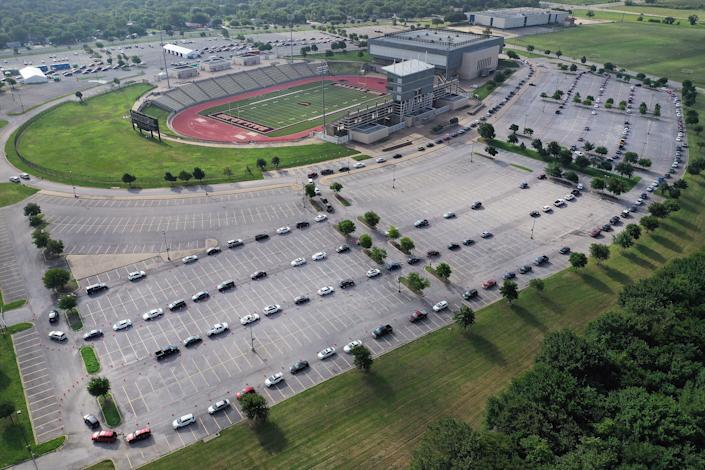 An aerial view from a drone as residents wait in line for the drive-thru COVID-19 testing center at the Ellis Davis Field House on July 2 in Dallas | Tom Pennington—Getty Images