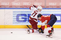 Carolina Hurricanes right wing Jesper Fast (71) and Florida Panthers defenseman MacKenzie Weegar (52) battle for the puck during the third period of an NHL hockey game, Monday, March 1, 2021, in Sunrise, Fla. (AP Photo/Wilfredo Lee)