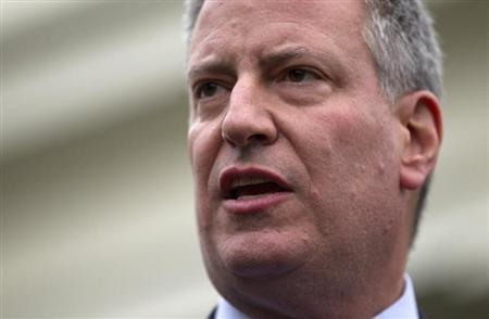 New York Mayor-elect Bill de Blasio speaks to the press outside the West Wing of the White House in Washington