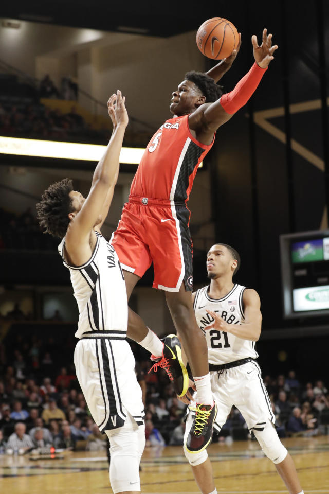 Georgia guard Anthony Edwards (5) drives against Vanderbilt's Braelee Albert, left, in the first half of an NCAA college basketball game Saturday, Feb. 22, 2020, in Nashville, Tenn. (AP Photo/Mark Humphrey)