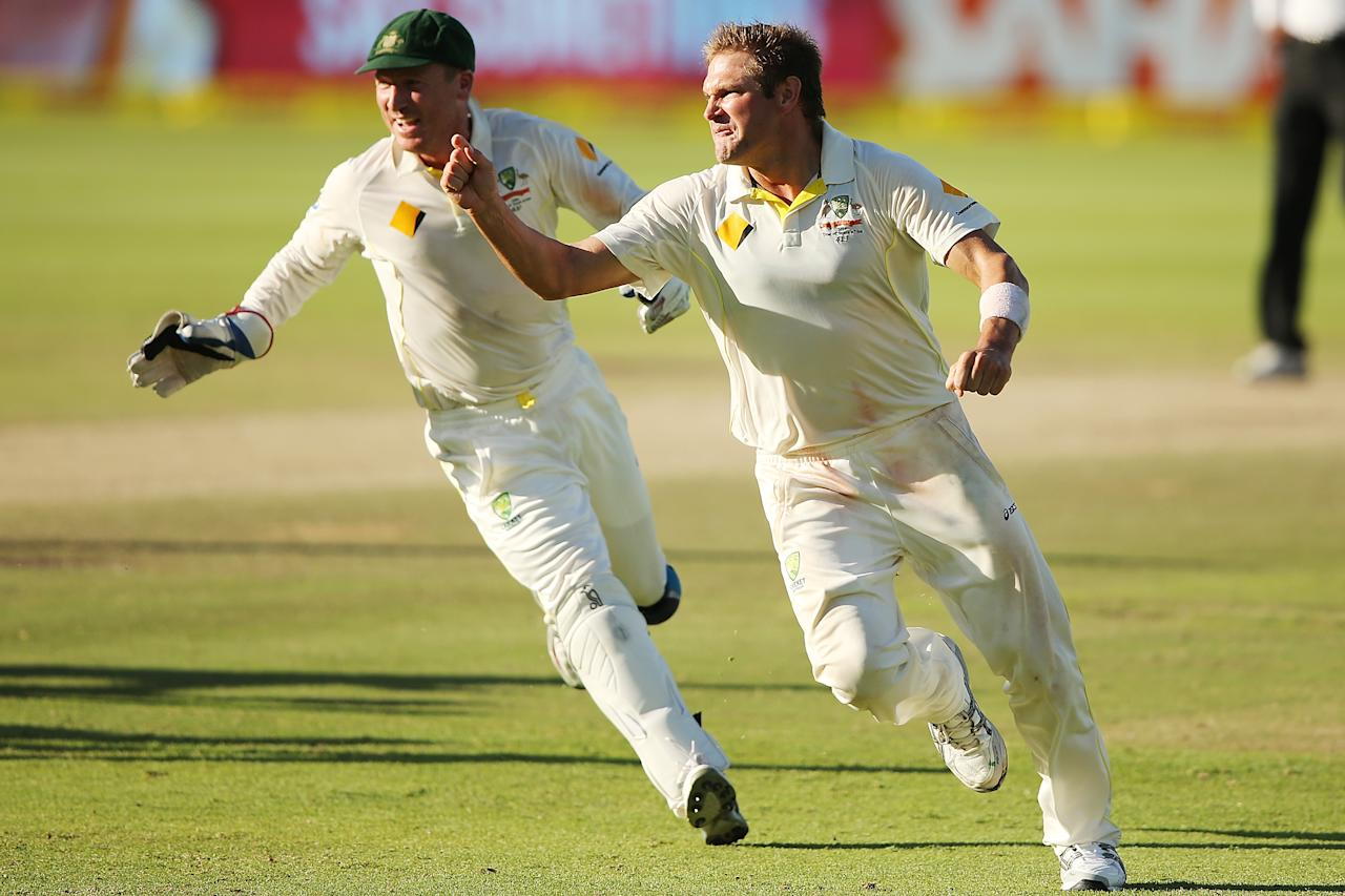 CAPE TOWN, SOUTH AFRICA - MARCH 05:  Ryan Harris celebrates as he takes the last wicket of Morne Morkel of South Africa to win the game during day 5 of the third test match between South Africa and Australia at Sahara Park Newlands on March 5, 2014 in Cape Town, South Africa.  (Photo by Morne de Klerk/Getty Images)