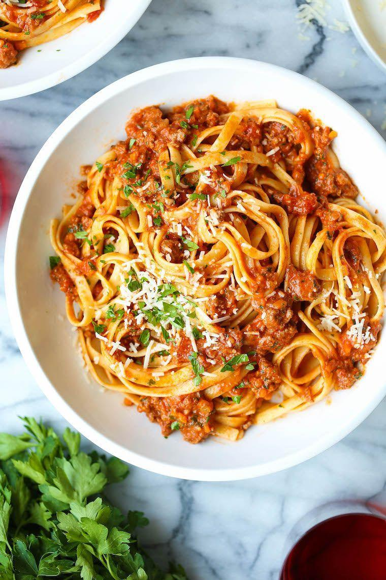 """<p>You only need one hour to make this bolognese that tastes like it's been simmering for hours, enjoyed over a hearty bowl of fettuccine. </p><p><strong>Get the recipe at <a href=""""https://damndelicious.net/2019/10/29/instant-pot-bolognese/"""" rel=""""nofollow noopener"""" target=""""_blank"""" data-ylk=""""slk:Damn Delicious"""" class=""""link rapid-noclick-resp"""">Damn Delicious</a>.</strong></p><p><strong><strong><strong><a class=""""link rapid-noclick-resp"""" href=""""https://www.amazon.com/Instant-Pot-Multi-Use-Programmable-Pressure/dp/B00FLYWNYQ/?tag=syn-yahoo-20&ascsubtag=%5Bartid%7C10063.g.36311962%5Bsrc%7Cyahoo-us"""" rel=""""nofollow noopener"""" target=""""_blank"""" data-ylk=""""slk:SHOP INSTANT POTS"""">SHOP INSTANT POTS</a></strong></strong><br></strong></p>"""