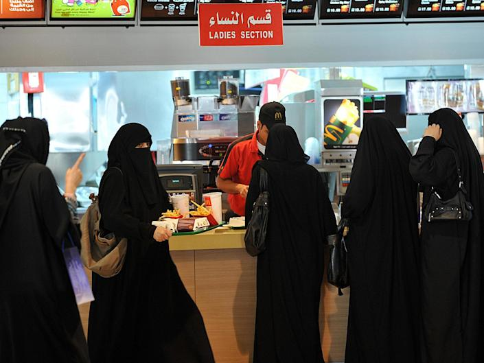 Saudi women wait in line in the 'ladies' section' at of a fast food restaurant in Riyadh, Saudi Arabia on 26 September 2011: Getty Images