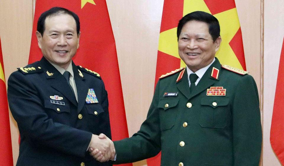 Chinese Defence Minister General Wei Fenghe (left) and Vietnamese counterpart General Ngo Xuan Lich discussed the South China Sea during talks in Hanoi in May. Photo: Handout