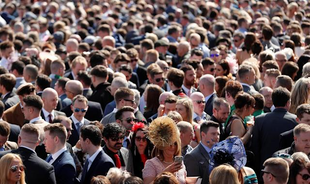 Horse Racing - Grand National Festival - Aintree Racecourse, Liverpool, Britain - April 14, 2018 Racegoers during the Grand National Festival Action Images via Reuters/Matthew Childs