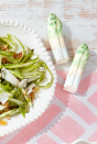 "<p>It's time to celebrate spring's bounty—and what better way to do so than with ""lettuceware""? This inspired trend, which involves vintage dishware in the shape of lettuce and other veggies, will delight all of your guests. Here, we used salt-and-pepper shakers in the shape of asparagus.</p><p><a class=""link rapid-noclick-resp"" href=""https://www.amazon.com/s?k=lettuce+plates&ref=nb_sb_noss&tag=syn-yahoo-20&ascsubtag=%5Bartid%7C10050.g.1652%5Bsrc%7Cyahoo-us"" rel=""nofollow noopener"" target=""_blank"" data-ylk=""slk:SHOP LETTUCEWARE"">SHOP LETTUCEWARE</a></p>"