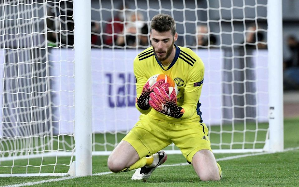 Manchester United's Spanish goalkeeper David De Gea stops the ball during the UEFA Europa League semi-final - FILIPPO MONTEFORTE/AFP via Getty Images
