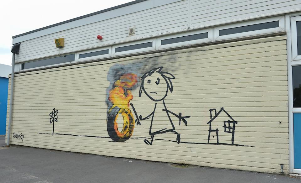 A Banksy mural which was painted on the side of one of the classrooms at Bridge Farm Primary in Bristol during half-term.