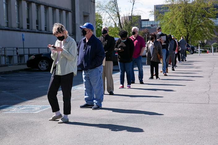 People line up outside a newly reopened career center
