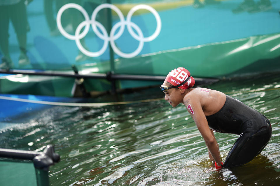 Alice Dearing, of Britain, exits the water after finishing the women's marathon swimming event at the 2020 Summer Olympics, Wednesday, Aug. 4, 2021, in Tokyo. (AP Photo/David Goldman)