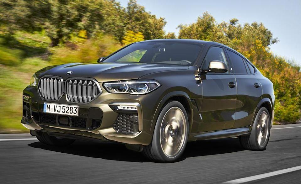 """<p>Amid the sea of <a href=""""https://www.caranddriver.com/features/g24419845/mid-size-luxury-crossovers-suvs-ranked/"""" rel=""""nofollow noopener"""" target=""""_blank"""" data-ylk=""""slk:mid-size luxury crossovers,"""" class=""""link rapid-noclick-resp"""">mid-size luxury crossovers,</a> a segment with at least 28 different SUVs to choose from, there are a few that stand out. The <a href=""""https://www.caranddriver.com/bmw/x5"""" rel=""""nofollow noopener"""" target=""""_blank"""" data-ylk=""""slk:BMW X5"""" class=""""link rapid-noclick-resp"""">BMW X5</a> and <a href=""""https://www.caranddriver.com/bmw/x6"""" rel=""""nofollow noopener"""" target=""""_blank"""" data-ylk=""""slk:X6"""" class=""""link rapid-noclick-resp"""">X6</a> pack a 523-hp twin-turbocharged 4.4-liter V-8 in M50i guise. M50i is BMW for quick: the X5 model <a href=""""https://www.caranddriver.com/reviews/a30864883/2020-bmw-x5-m50i-by-the-numbers/"""" rel=""""nofollow noopener"""" target=""""_blank"""" data-ylk=""""slk:gets to 60 mph in 3.9 seconds"""" class=""""link rapid-noclick-resp"""">gets to 60 mph in 3.9 seconds</a>, while the <a href=""""https://www.caranddriver.com/reviews/a29751680/2020-bmw-x6-drive/"""" rel=""""nofollow noopener"""" target=""""_blank"""" data-ylk=""""slk:X6 M50i did it in 3.8 seconds"""" class=""""link rapid-noclick-resp"""">X6 M50i did it in 3.8 seconds</a>. The 553 lb-ft of torque hits low at 1800 rpm, and the launch-control revs to nearly 3000 rpm system maximum take-off thrust. These new sporty SUVs match the straight-line performance of the <a href=""""https://www.caranddriver.com/reviews/a15079837/2017-bmw-x6-m-test-review/"""" rel=""""nofollow noopener"""" target=""""_blank"""" data-ylk=""""slk:previous generation X6 M"""" class=""""link rapid-noclick-resp"""">previous generation X6 M</a> that had 576 horsepower. Spoiler alert, the high-performance X5 M and X6 M are ranked higher on this list. </p><p><a class=""""link rapid-noclick-resp"""" href=""""https://www.caranddriver.com/bmw/x5/specs"""" rel=""""nofollow noopener"""" target=""""_blank"""" data-ylk=""""slk:MORE X5 SPECS"""">MORE X5 SPECS</a></p><p><a class=""""link rapid-noclick-resp"""" href=""""https://www.caranddr"""