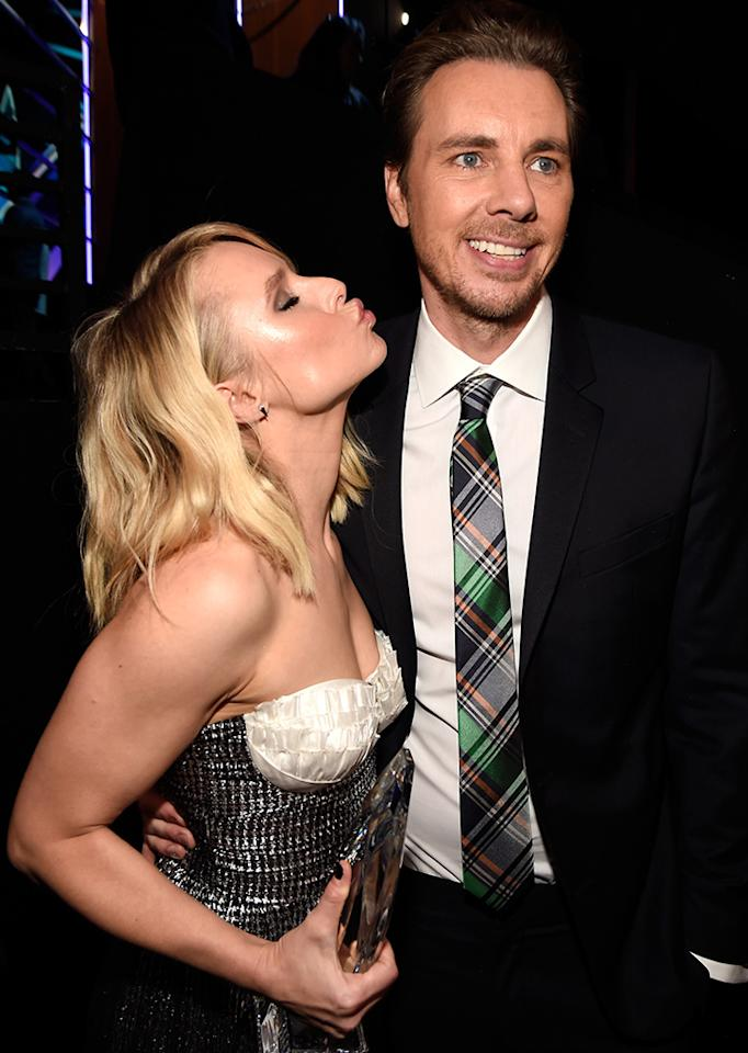 <p>Actress Kristen Bell was all set to give husband Dax Shepard a smooch at the People's Choice Awards. Too bad he didn't seem to notice! (Photo: Kevin Mazur/WireImage) </p>