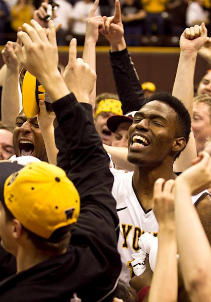 Univeristy of Wyoming forward Derek Cooke Jr. celebrates with fans after they rushed the floor prior to the Cowboys defeating San Diego State at the Arena- Auditorium in Laramie, Wyo. (AP Photo/Jeremy Martin)