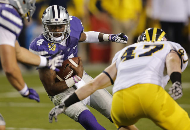 Kansas State quarterback Daniel Sams (4) scrambles as Michigan linebacker Jake Ryan (47) defends during the first half of the Buffalo Wild Wings Bowl NCAA college football game on Saturday, Dec. 28, 2013, in Tempe, Ariz. (AP Photo/Matt York)