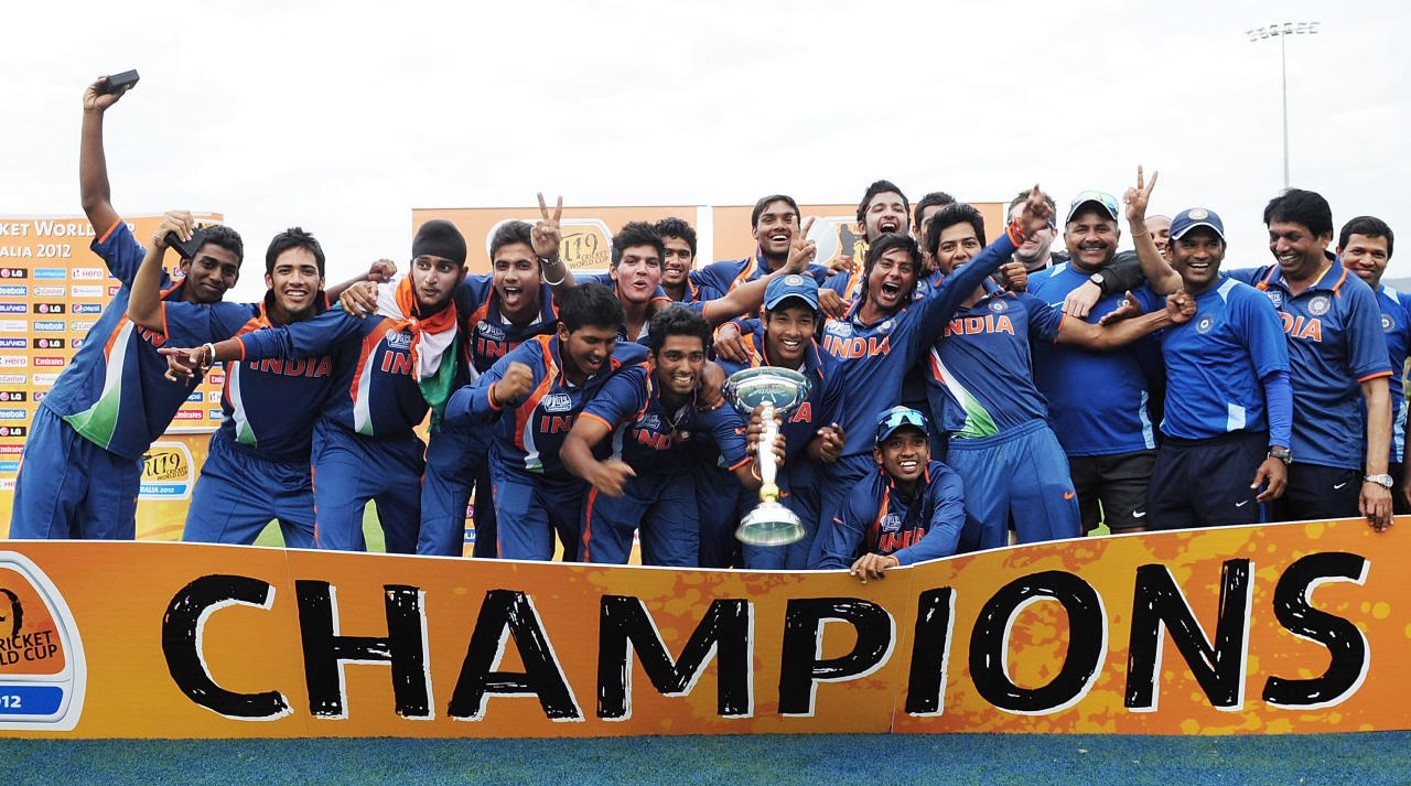 TOWNSVILLE, AUSTRALIA - AUGUST 26:  The Indian team celebrate winning the 2012 ICC U19 Cricket World Cup Final between Australia and India at Tony Ireland Stadium on August 26, 2012 in Townsville, Australia.  (Photo by Ian Hitchcock-ICC/Getty Images)