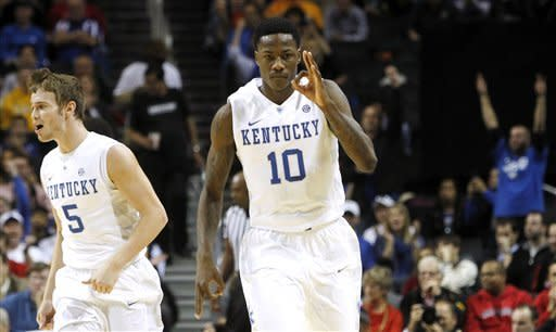 Kentucky's Archie Goodwin (10) reacts with Jarrod Polson (5) after scoring against Maryland during the first half of their NCAA college basketball game in the Barclays Center Classic, Friday, Nov. 9, 2012, in New York. Kentucky won 72-69. (AP Photo/Jason Decrow)