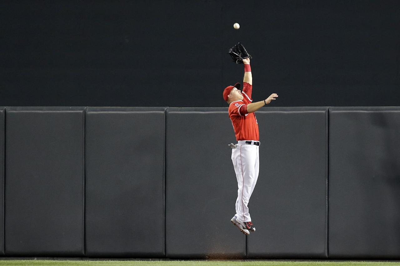 Los Angeles Angels center fielder Mike Trout makes a leaping catch on a fly ball by Baltimore Orioles' Nick Markakis in the fifth inning of a baseball game, Wednesday, July 30, 2014, in Baltimore. (AP Photo/Patrick Semansky)