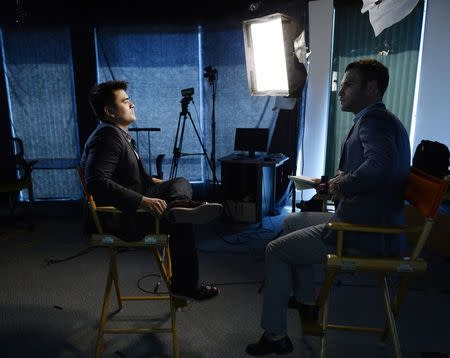 """Journalist and director of film """"Documented"""", Jose Antonio Vargas (L), poses for a photograph in Los Angeles, Californa June 18, 2014. REUTERS/Kevork Djansezian"""