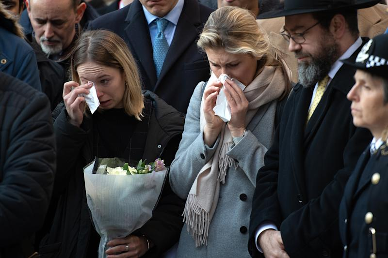 Members of the public attend a vigil for stabbing victims Jack Merritt, 25, and Saskia Jones, 23 of the London Bridge attack and to honour the public and emergency services who responded. Getty Images.
