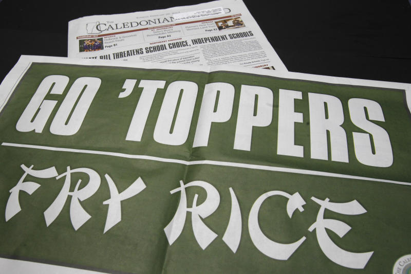 Vt. paper defends 'fry Rice' sign supporting team