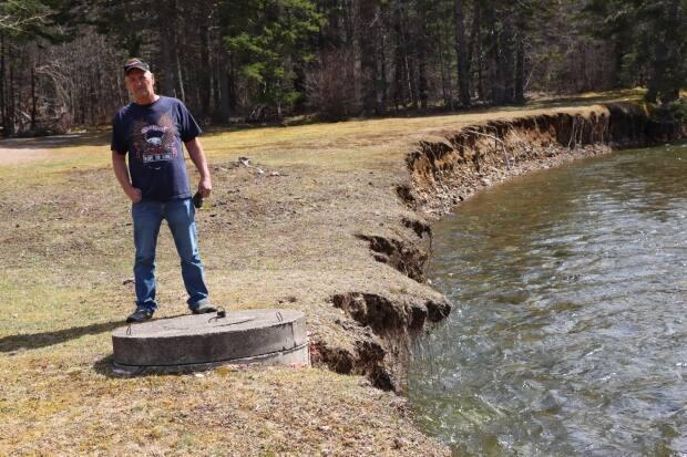 Doyle stands in the front yard of his Margaree Valley property.