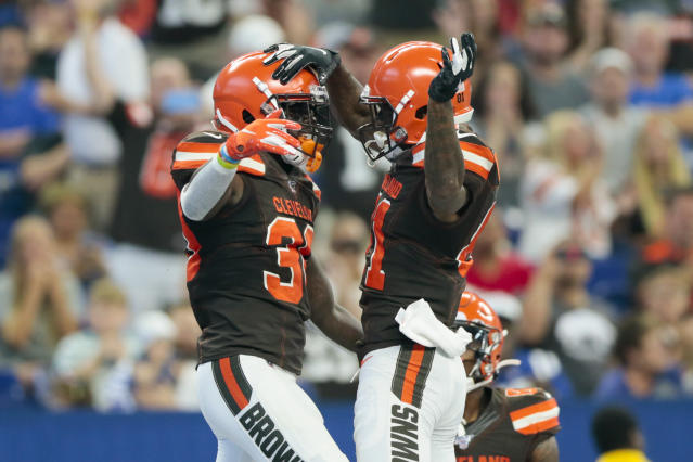 Cleveland Browns running back D'Ernest Johnson (30) celebrates his touchdown with wide receiver Rashard Higgins (81) during the first half of an NFL preseason football game against the Indianapolis Colts in Indianapolis, Saturday, Aug. 17, 2019. (AP Photo/AJ Mast)