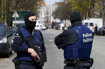 Belgium police officers secure the access during a police operation in Etterbeek, near Brussels, Belgium, April 9, 2016. REUTERS/Yves Herman